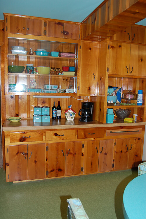 built in shelves in mid century knotty pine kitchen