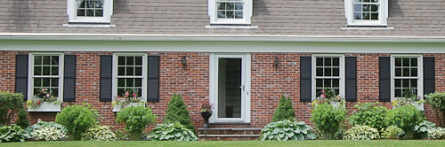 Window Boxes On A Dutch Colonial House