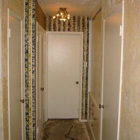flocked wallpaper in the hallway