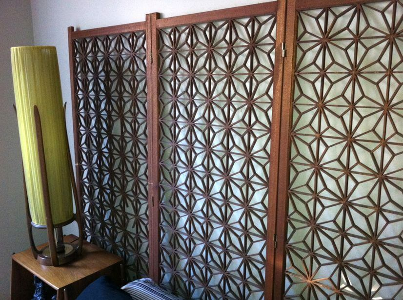 mid century modern decorative screen used as a headboard