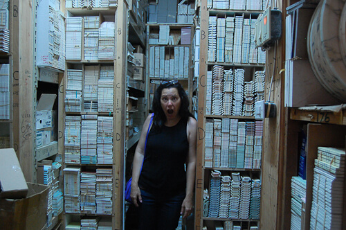 pam tours the basement storage area of world of tile