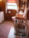 A knotty pine pink bathroom — channeling Marilyn Monroe