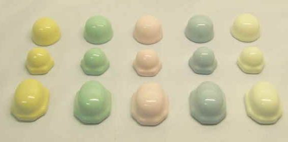toilet bolt caps in pastel pink, green, blue, yellow and ivory