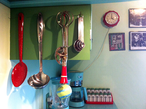 vintage red utensils in jadeite color kitchen