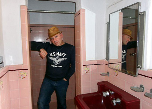 thommy in one of the pink bathrooms in the leo carrillo ranch