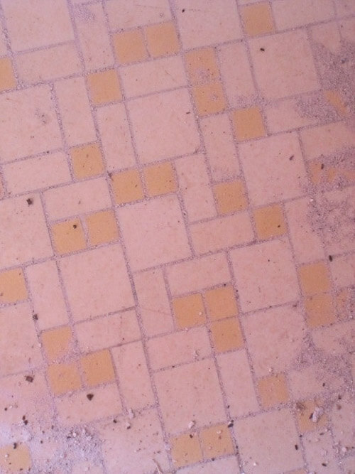 pink tile in gas station bathroom floor