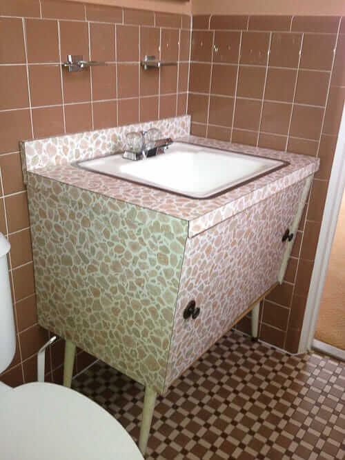 Marvelous bathroom vanity with wild laminate pattern