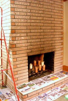 Before and after shots of a dirty brick fireplace that was stained instead of attempting to clean or paint the brick -- the results are fantastic!