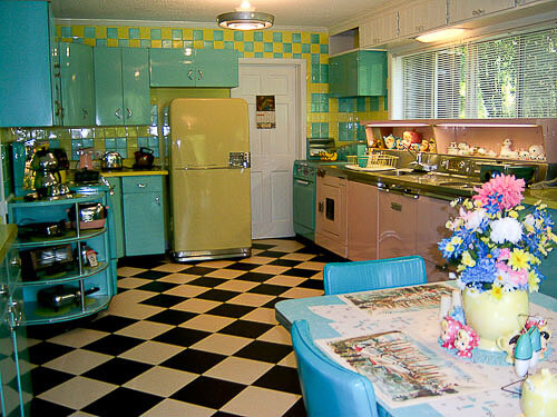 blue yellow and pink kitchen with black and white checkerboard floors