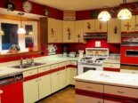 Greg and Tammy's red farm kitchen remodel — full of retro charm