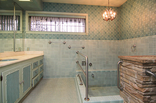 bathroom with tiled sunken tub