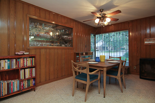 eat in kitchen wood paneled walls