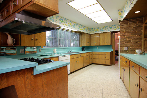 wonderful 1950s wood kitchen with blue countertops and wallpaper