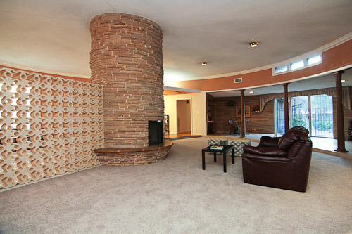 round two way fireplace with midcentury modern room dividers