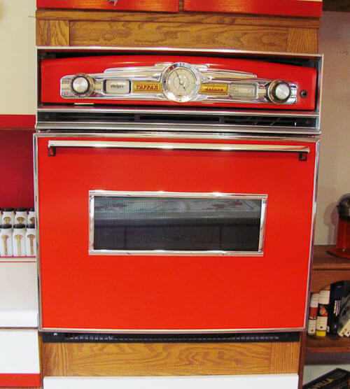 a built in oven painted red and converted to look retro