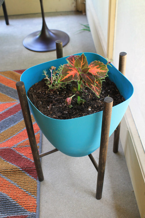 Mid century inspired planter stand made with dowel rods