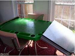 a kitchen table that transforms into a poker table - the Playdine