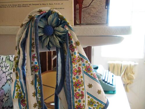 vintage curtain tie back used as apron hook