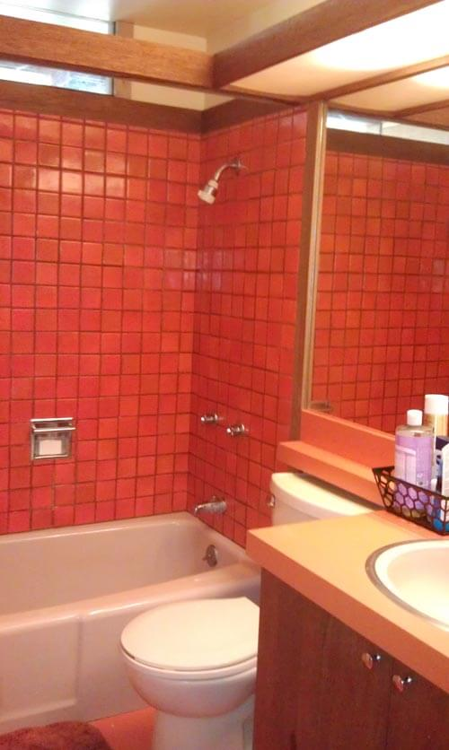mid century mod orange bathroom tile