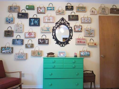 vintage-Enid-Collins-Purse-collection on wall