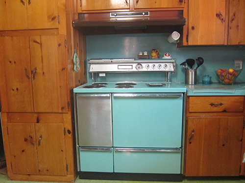 Betty-Crafter-Tuq-stove-knotty-pine-kitchen