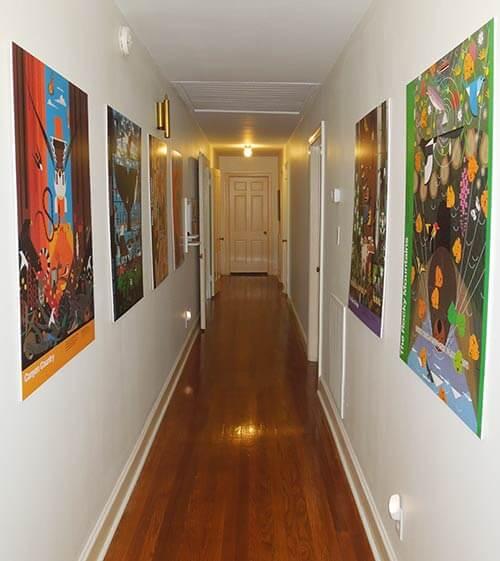 Charlie-Harper-posters-in-hallway
