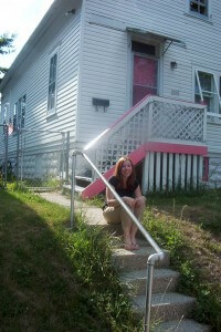 kate with her first house - a cape cod fixer upper built in 1890