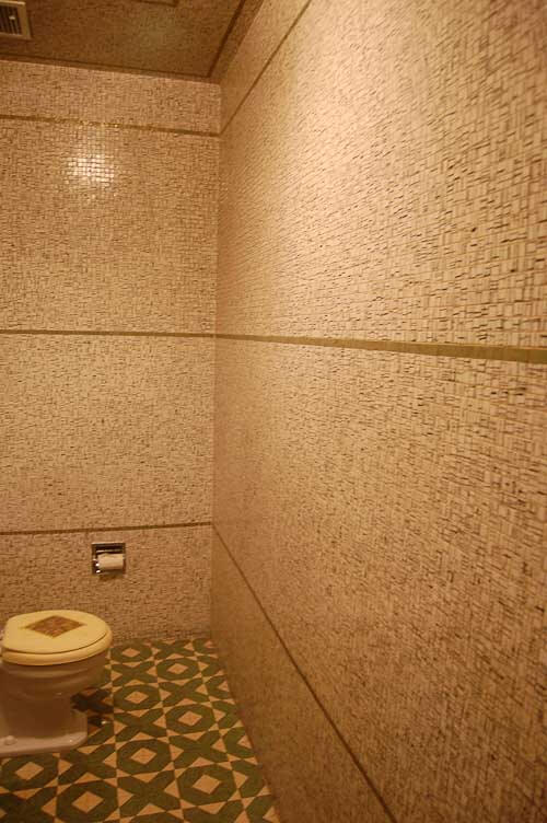 bathroom with metallic tile