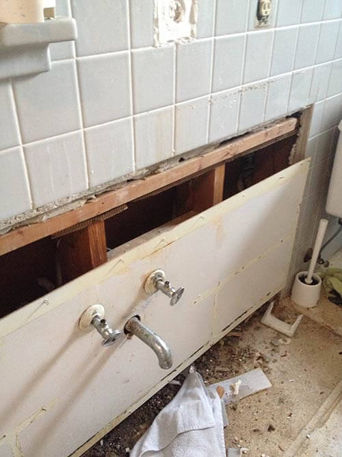 Inspirational bath vanity removed with missing tile