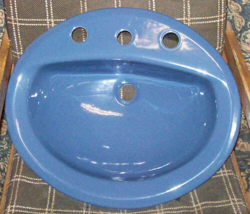 Blue 20 and a half X 17 and a half inch  8 inch spread oval lavatory sink