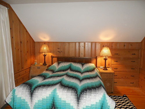 knotty-pine-bedroom-in-attic