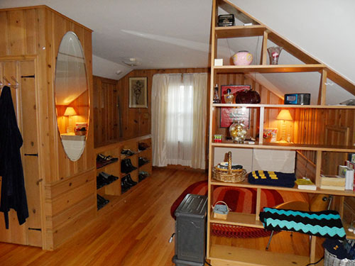 knotty-pine-room-with-divider-shelf