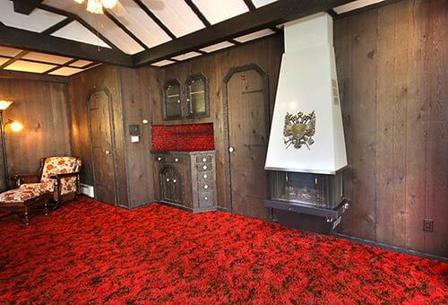 Mid-century-midieval-room-with-wall-mount-fireplace