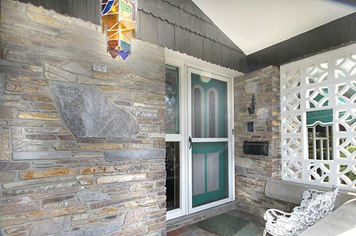 Mid-century-stone-porch-with-decorative-cement-block