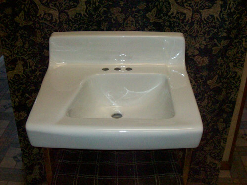 White ceramic 19 and a half inches x 24 inches 4 inch spread wall hung lavatory sink