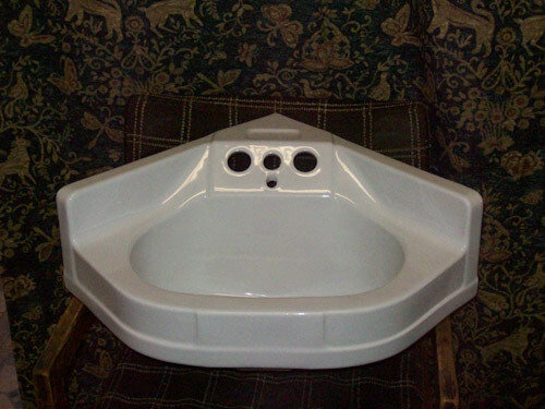 White ceramic corner sink 4 hole