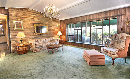 mid-century-retro-living-room-stone-wall-and-picture-window