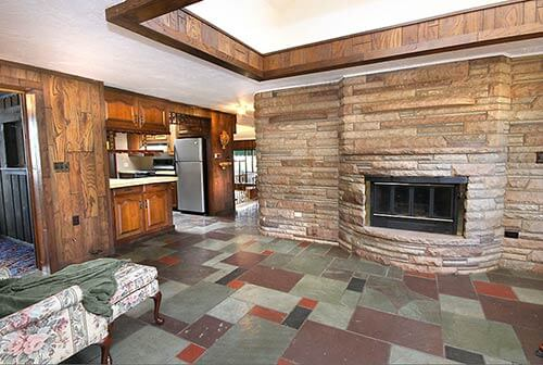 mid-century-retro-stone-fireplace-with-slate-floor