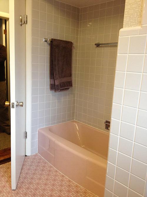 Bradbury Atomic Age Wallpaper Makes These Two 1950s Pink Bathrooms Even More Luscious Retro