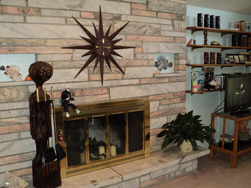mid century fireplace with starburst clock