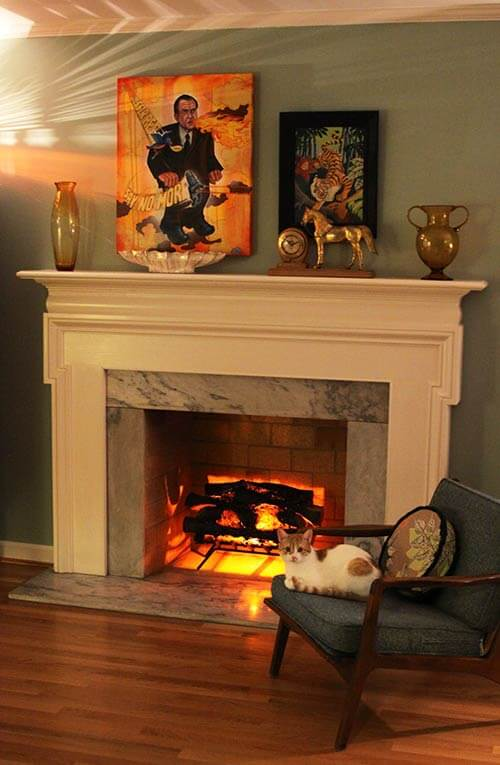 Decorating fireplaces 10 ideas from reader living rooms for How to decorate living room with fireplace