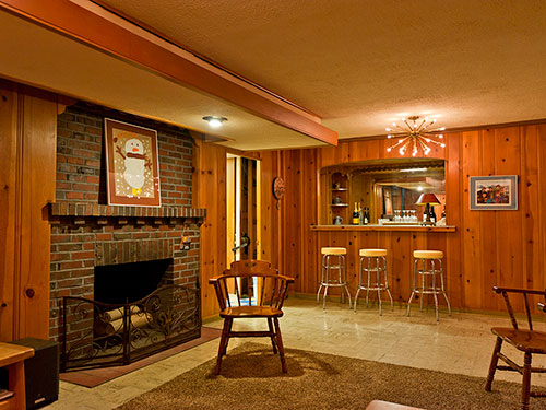 knotty-pine-rec-room-with-sputnik-light-and-fireplace