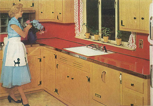 Vintage-kitchen-with-red-laminate-counters-and-metal-edging