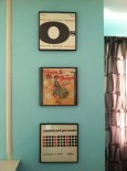 framed LPs on a wall