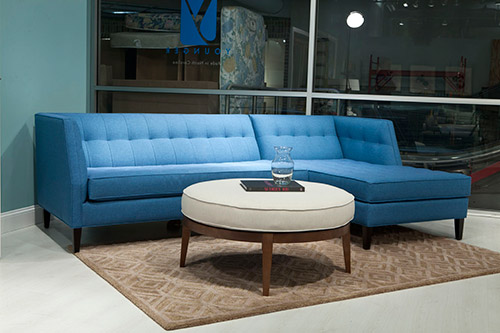 blue sectional sofa with recliners chaise showroom younger furniture avenue navy for sale