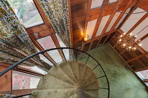 70s-house-spiral-staircase-green-shag
