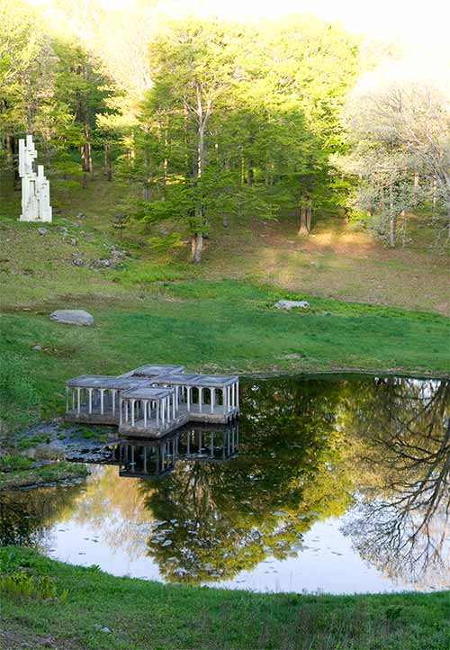 Pond and sculpture Glass house