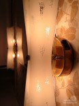 New vintage wallpaper and lighting for Pam's bathroom: Beige, brown, yellow, gray, metallic gold and white glowy dream