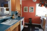 """Sarah's """"super economical"""" retro kitchen remodel featuring salvaged vintage wood cabinets"""