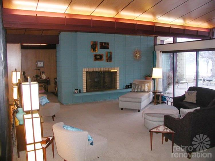 What paint colors or other design ideas should Kathy use to better integrate her block fireplace into her beautiful mid-century modern house?